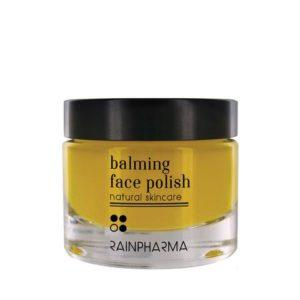 glazen pot met gele inhoud, zwart deksel en zwarte tekst (balming face polish)